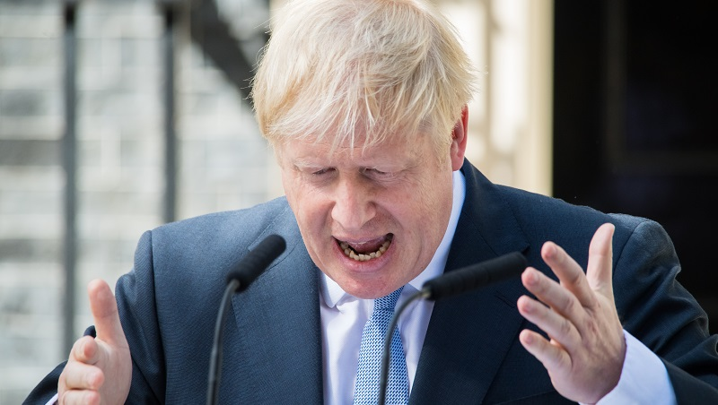 Boris Johnson outside Number 10 Downing Street giving a speech and gesturing with his hands