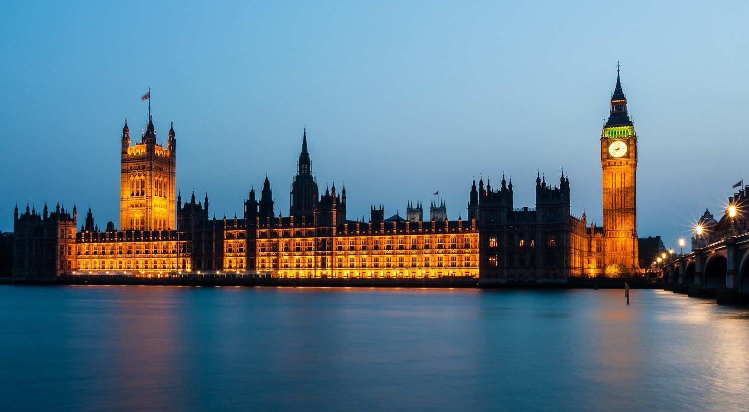A night time scene of the Houses of Parliament in London.