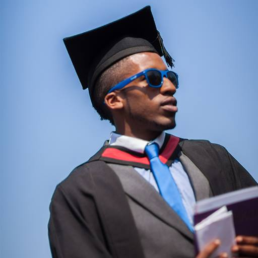 Photo taken from below of a male graduate wearing sunglasses and his robes at graduation.