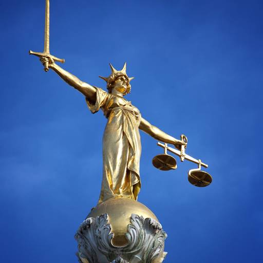 Justice statue on top of Old Bailey in London