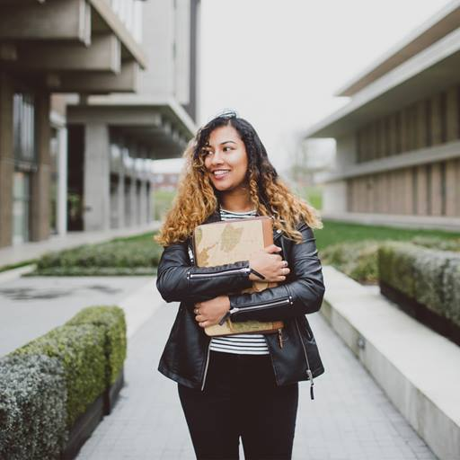 Image of a female student holding a laptop