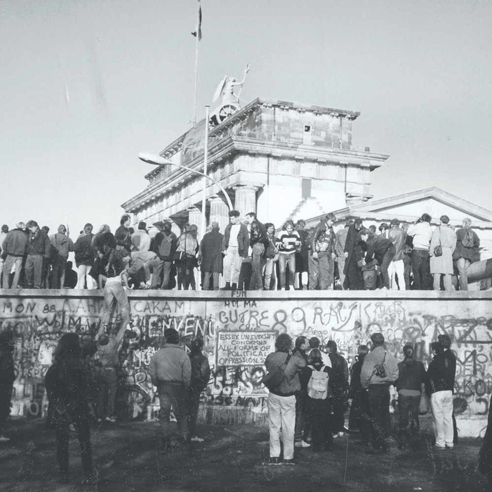 Essex students making their mark on the Berlin Wall, 1989