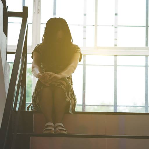 Photo of woman sitting on stairs