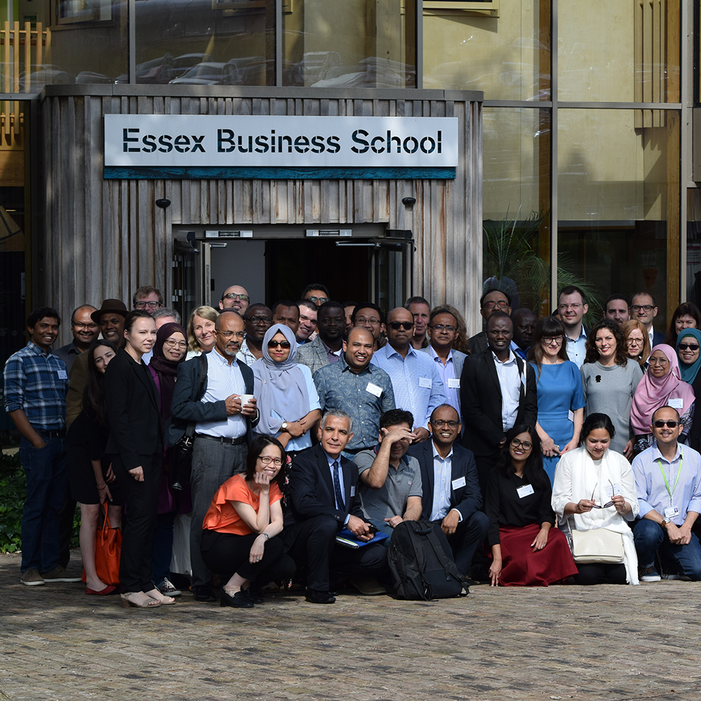 Delegates atending the Accounting and Accounting in Emerging Economies 2019 conference pose in front of the Essex Business School Building.