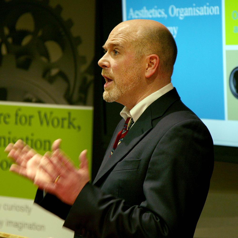 A speaker delivers a keynote speech at the Centre for Work, Organisation and Society (CWOS) launch event.