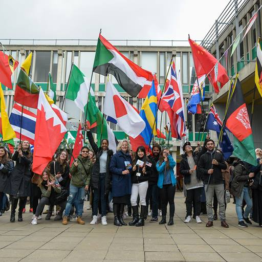 International students with their countries flags