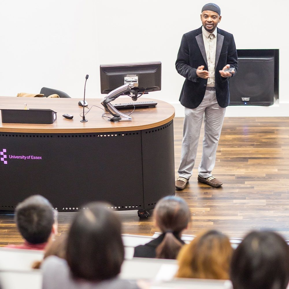 Lecturer speaking to a room of students