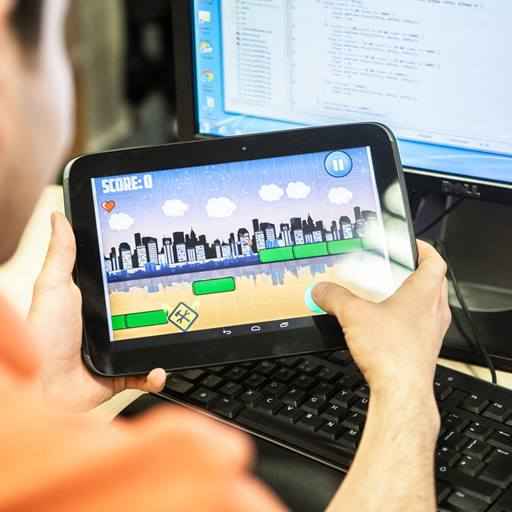 Person playing a game on a tablet device