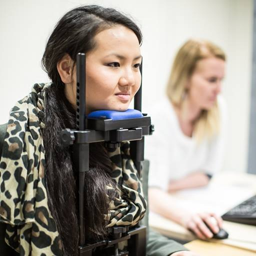 Image of a female student involved in a psychology eye-tracking experiment