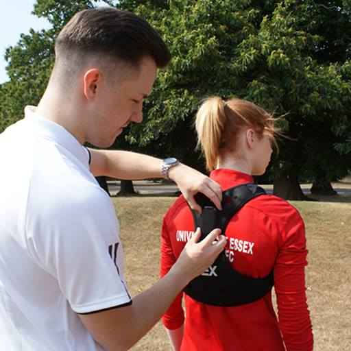 Athlete being fitted with GPS tracker