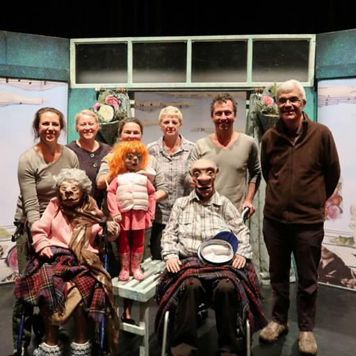 Group photograph of the cast and puppets from Az2b Theatre Company and staff from the School of Health and Social Care