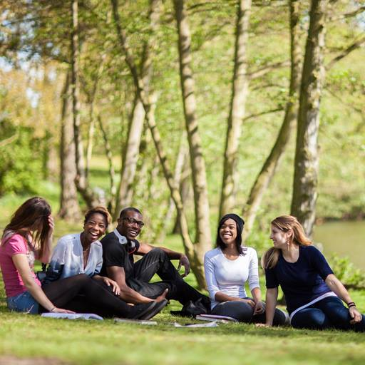 Students beside the lake at our Colchester Campus