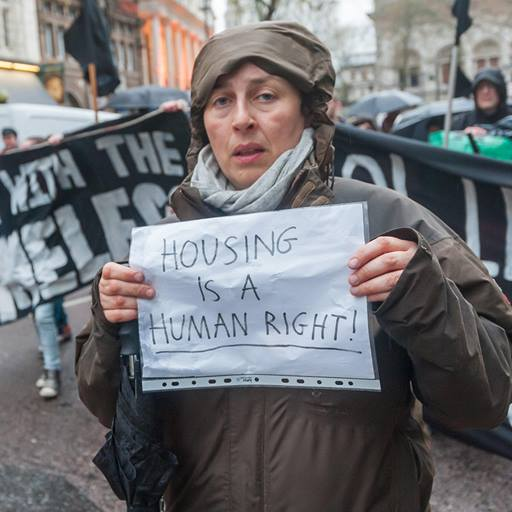 Picture of woman holding a poster about human rights