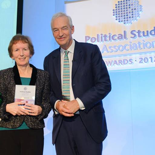 Professor Vicky Randall receives award from Jon Snow