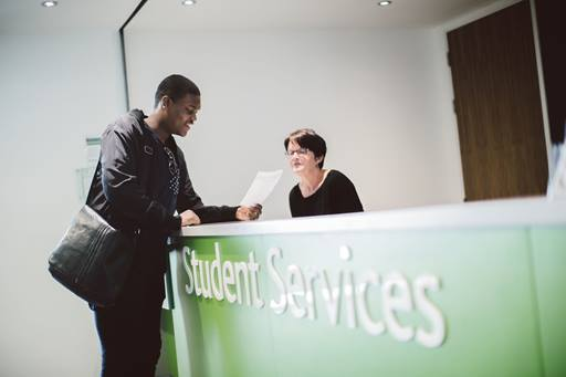 A student visiting student services