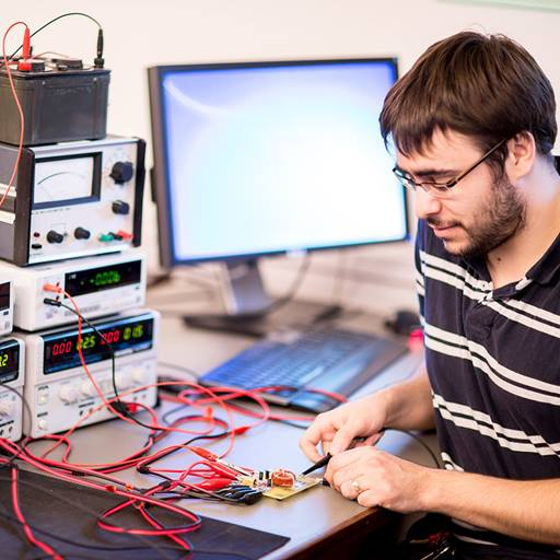 This image is of a male electronic engineering research student in a lab doing some project work.