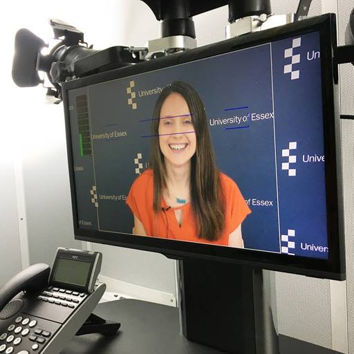 TV screen showing a woman giving a TV interview
