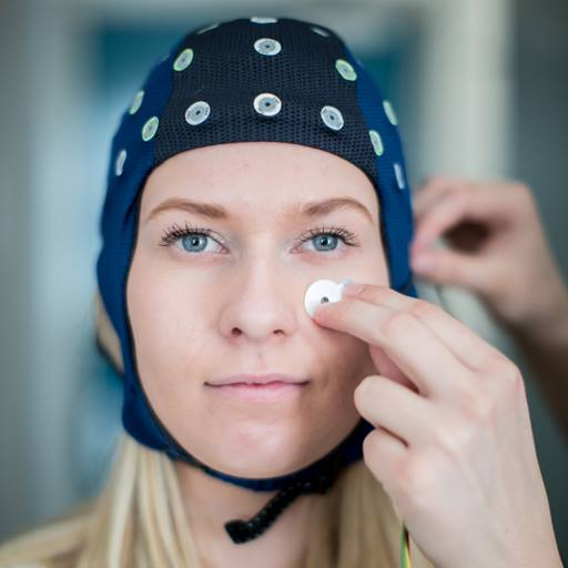 Woman with a sensor net on her head for an experiment