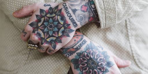 Tattoos on Matt Lodder's hands