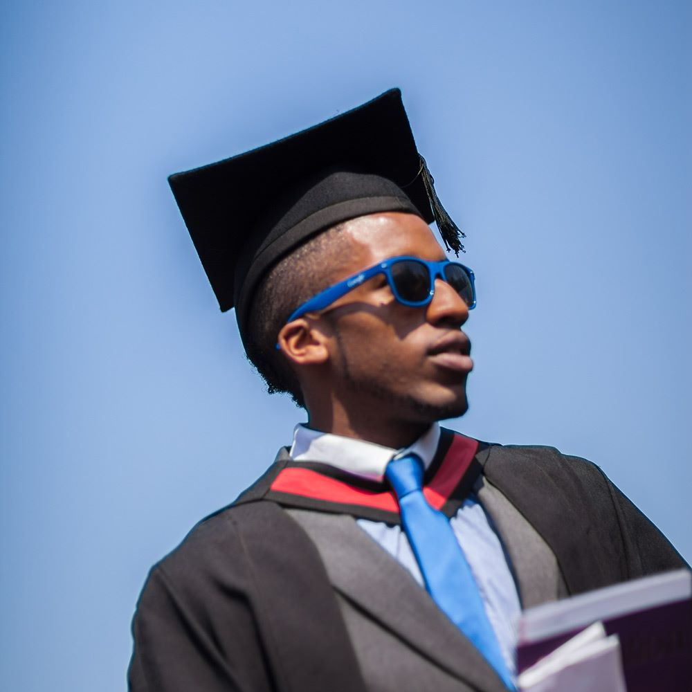 Student at graduation wearing sunglasses
