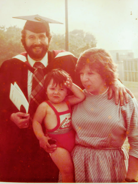 Mike Rose with his wife and son on his graduation day in 1982