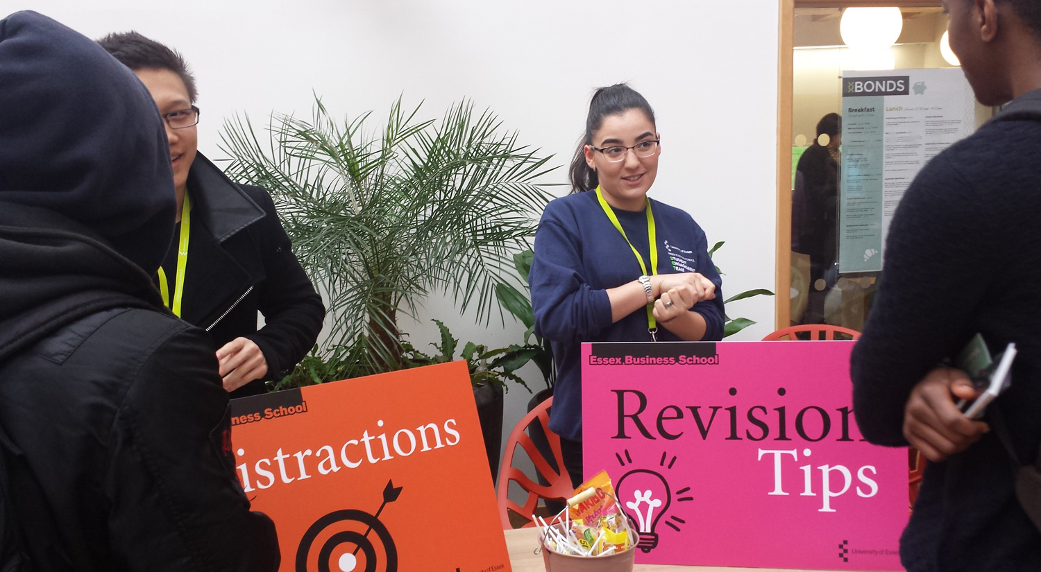 Students standing with revision posters