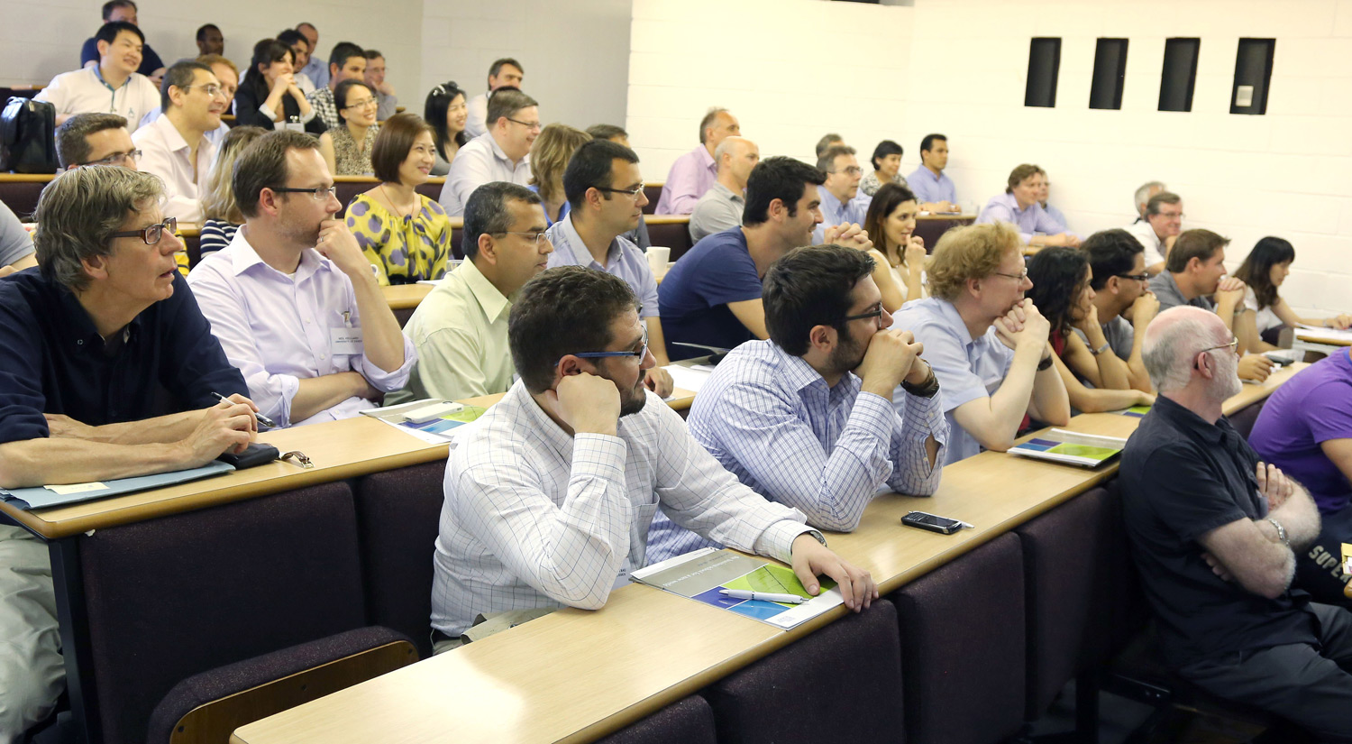 Academics listening to a lecture