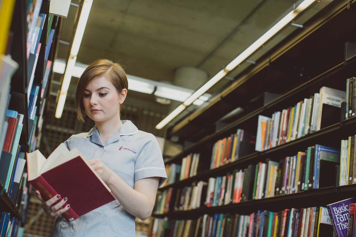 A student nurse doing research in the library