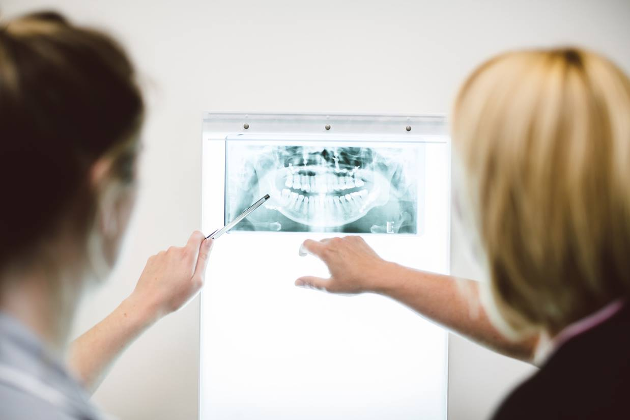 Two students examining an x-ray of the mouth