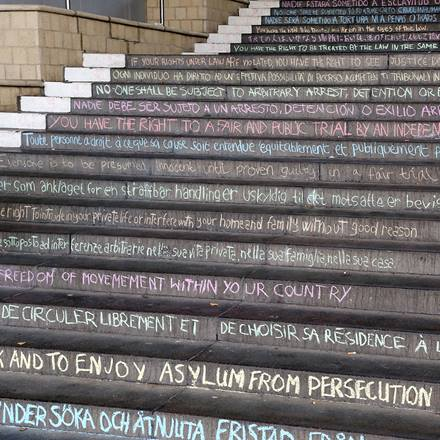 Steps on campus with the human rights declaration chalked on them