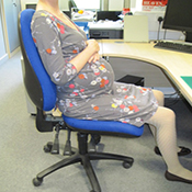 Pregnant woman sitting at desk