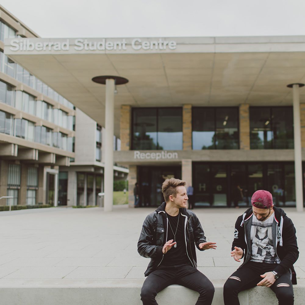 Students sitting outside student centre