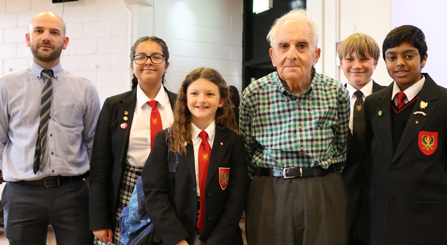 Holocaust survivor Frank Bright with students from The Gilberd School