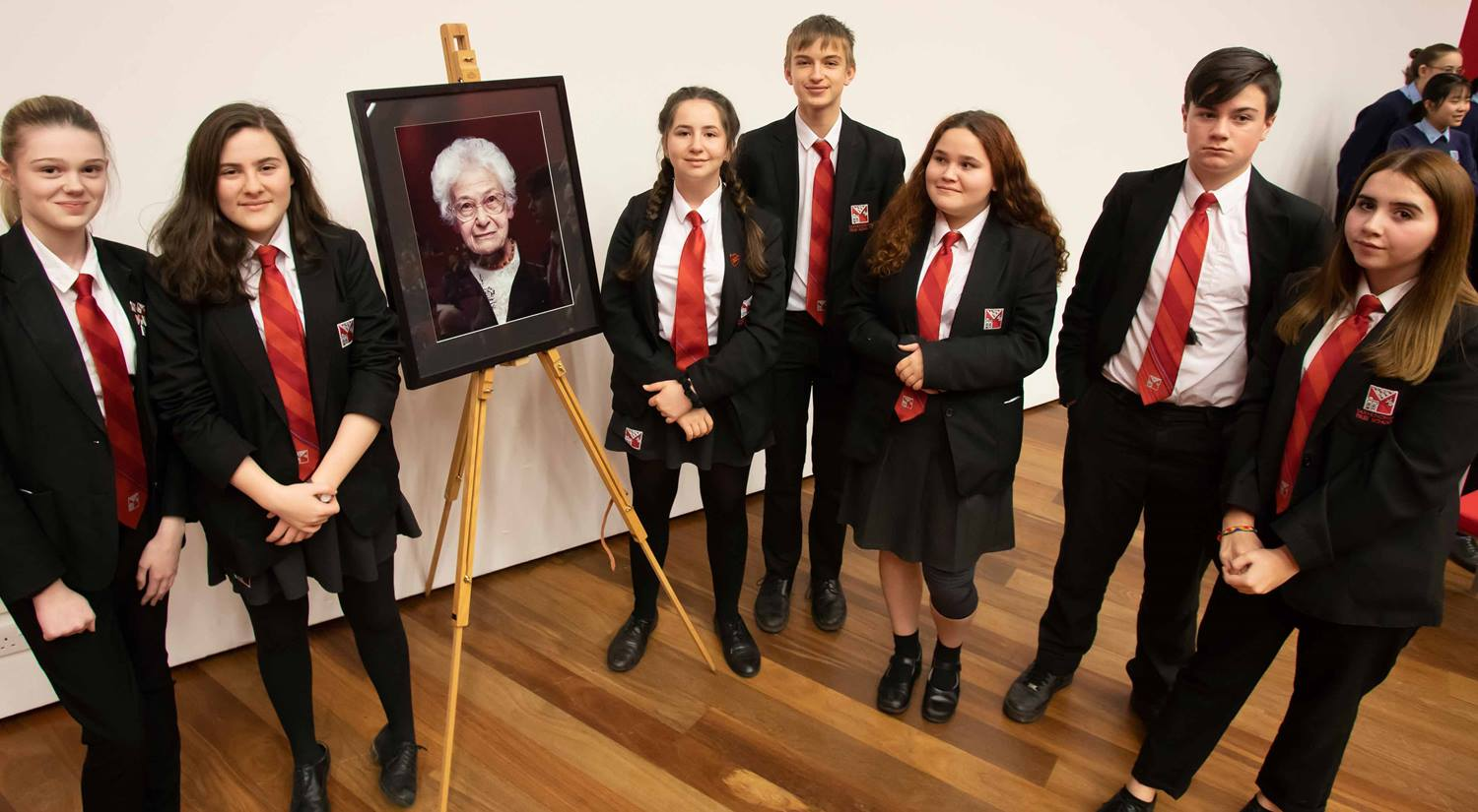 Dora Love Prize 2020 runners-up SET Saxmundham School, with a portrait of Dora Love