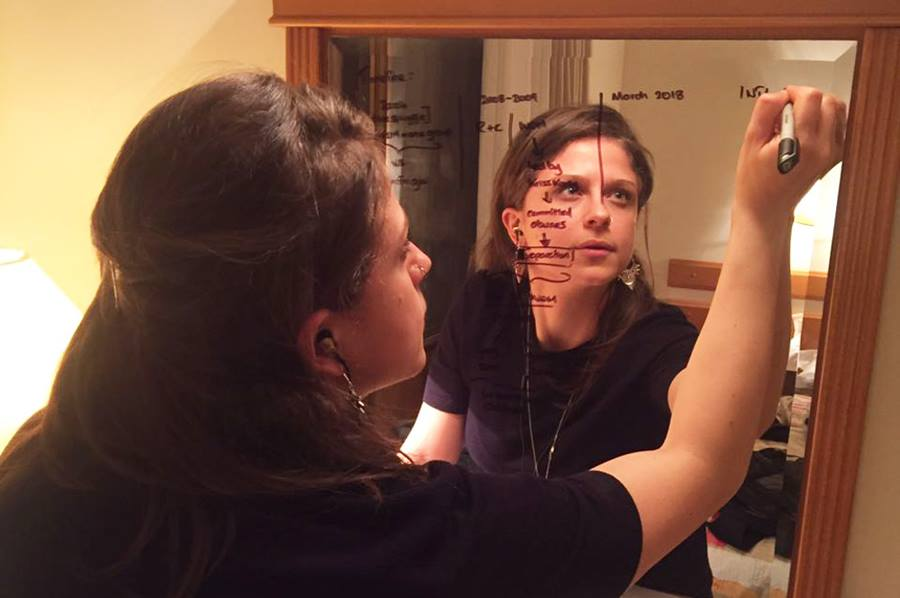 Rasha Mohamed writes notes on a mirror