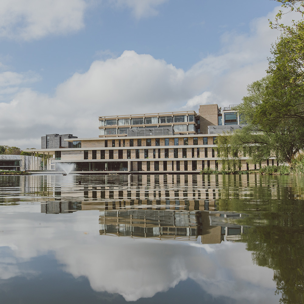 Colchester Campus lake and surrounding buildings