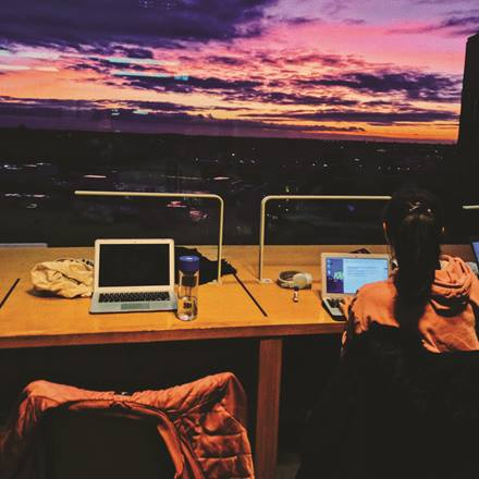 Studying overlooking the sunset