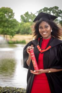 Study abroad student, Fiona in their graduation gown with their certificate